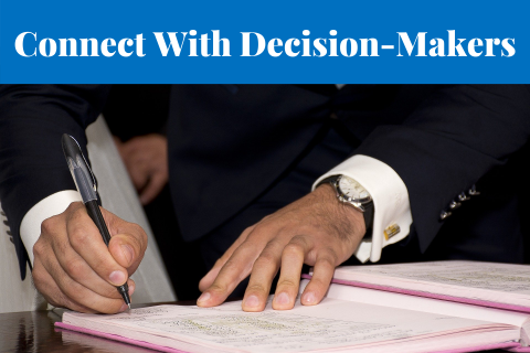 Connect With Decision-Makers - hands signing a document