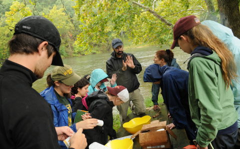 Smithsonian-Mason Semester students testing water on learning about watershed management on the Shenandoah River. Photo by Evan Cantwell/Creative Services/George Mason University.