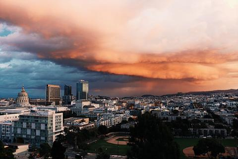 Storm clouds roll in over a city